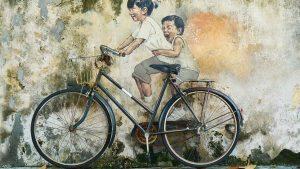 Boys on a bike enjoying themselves