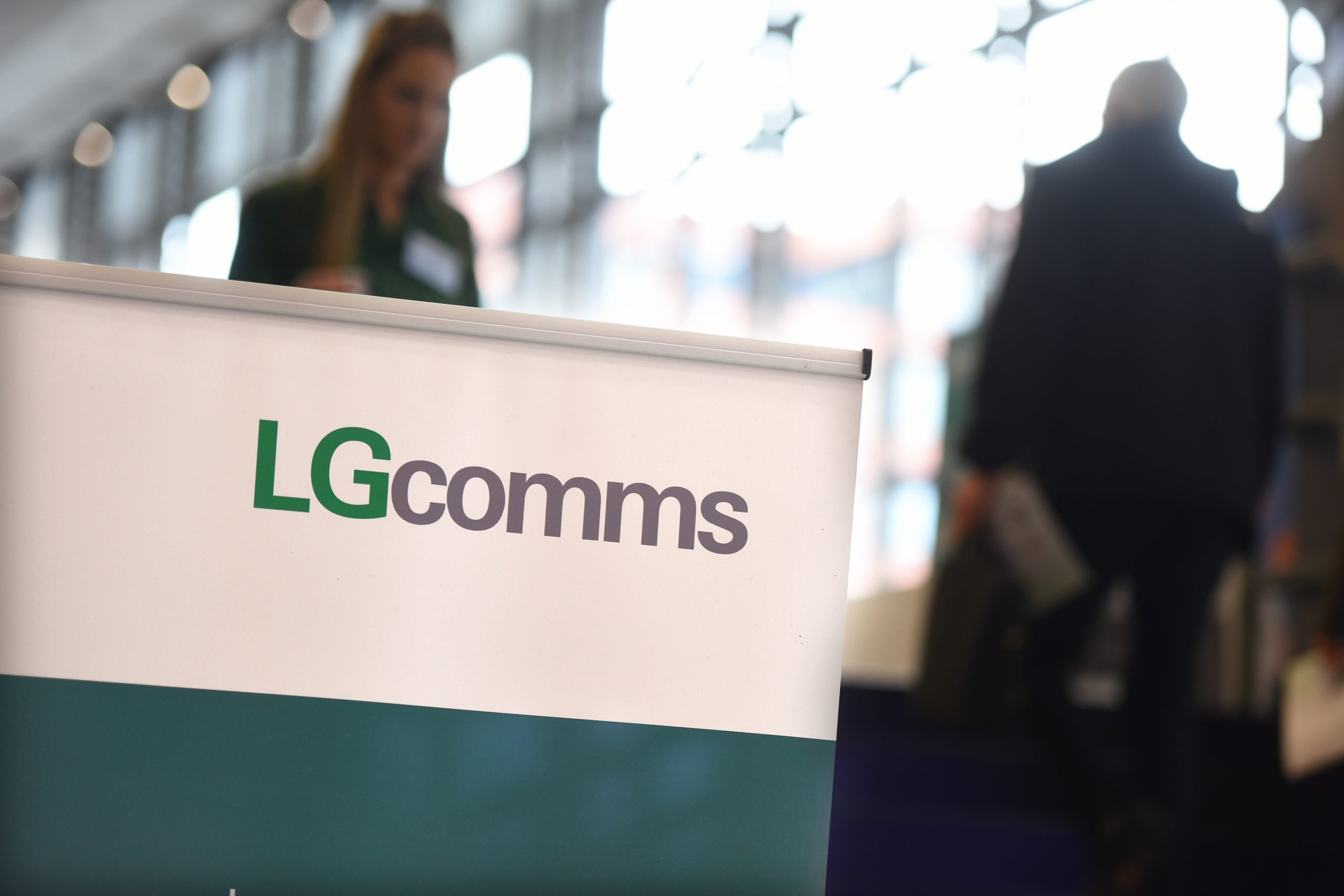A banner with the LGcomms logo