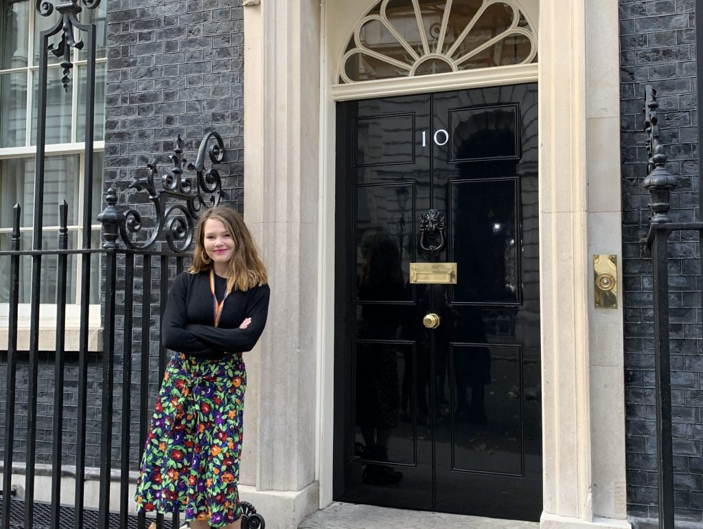 Portrait image of Abigail Emery standing outside 10 Downing street