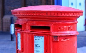 A red Royal Mail letter box