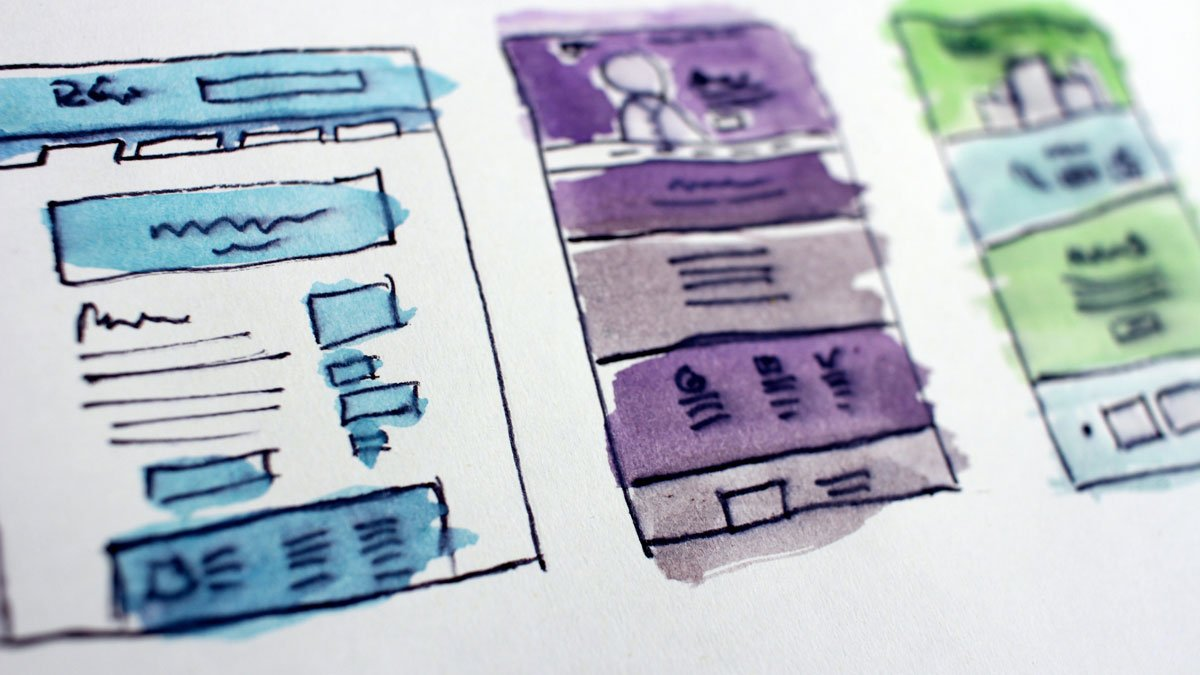 A rough sketch of three different website designs in blue, purple and green
